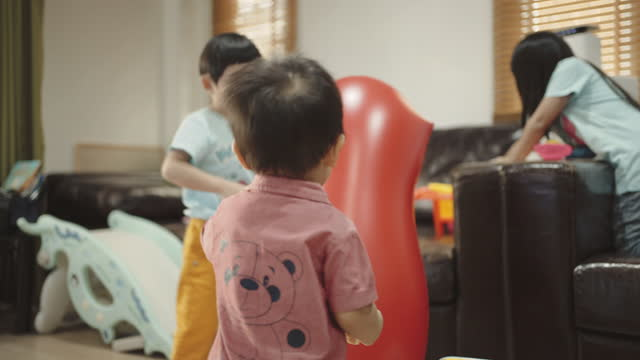 asian kids playing in living room - youth organisation stock videos & royalty-free footage