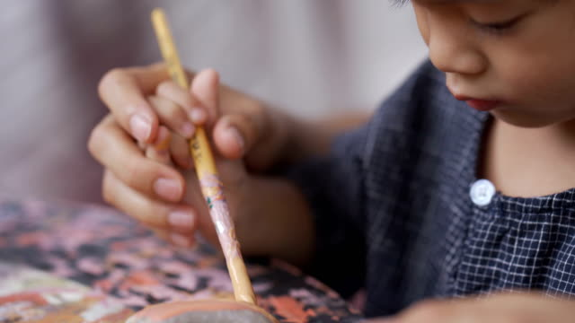 asian little boy painting stone with mom. - artist stock videos & royalty-free footage