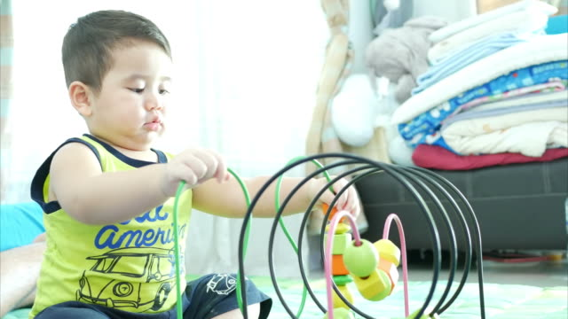 asian little boy playing toy - preschool student stock videos and b-roll footage
