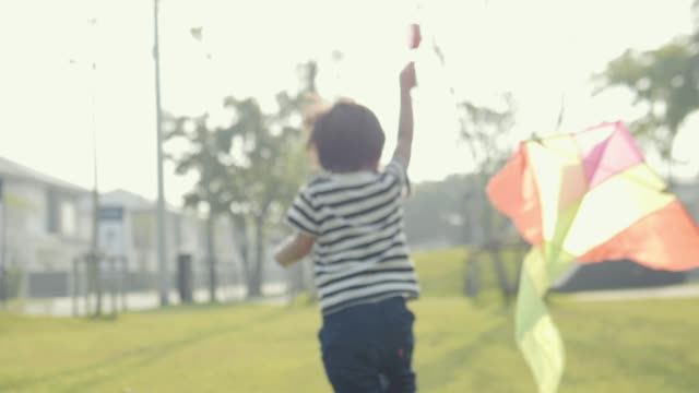 asian little boy running kite freedom concept summer nature field at sunny day. - kid with kite stock videos & royalty-free footage