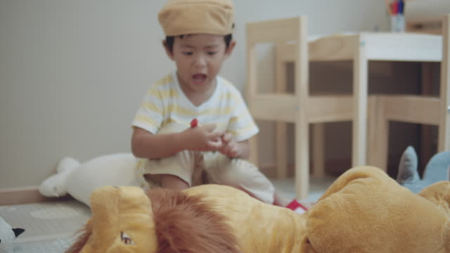 Asian little child playing at home