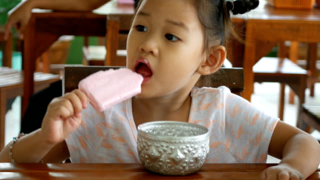 asian little girl eating ice cream