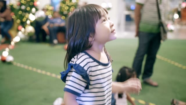 asian little girl excitement in christmas festival - 4 5 years stock videos and b-roll footage