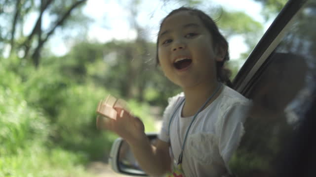 asian little girl in car travel with family, lifestyle freedom tourist - durability stock videos & royalty-free footage