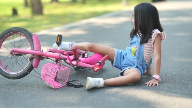 asian little girl ride bicycle in garden - falling stock videos & royalty-free footage