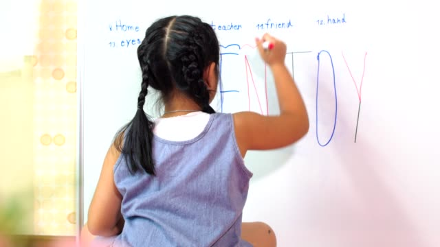 asian little girl writing on classroom white board, education concept - english language stock videos and b-roll footage