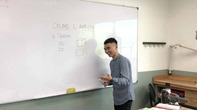 asian malay smiling male teacher giving lectures to his student at college classroom - whiteboard stock videos & royalty-free footage