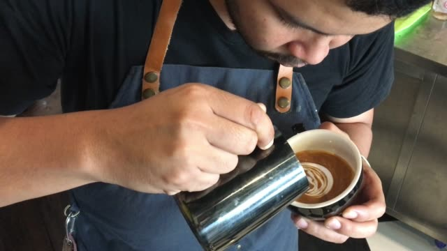 asian male barista create latte art at coffee shop - disposable stock videos and b-roll footage