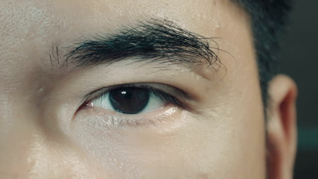 asian male brown eye (close-up) - eye stock videos & royalty-free footage