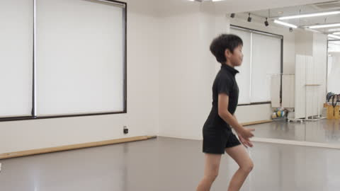 asian male child of a ballet students taking taking lesson by asian female instructor. - leotard stock videos & royalty-free footage