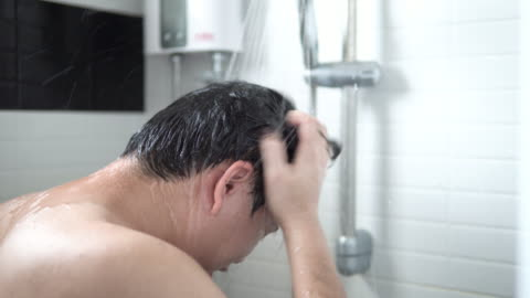 asian man are taking hair and body wash shower in bathroom. - wet hair stock videos & royalty-free footage