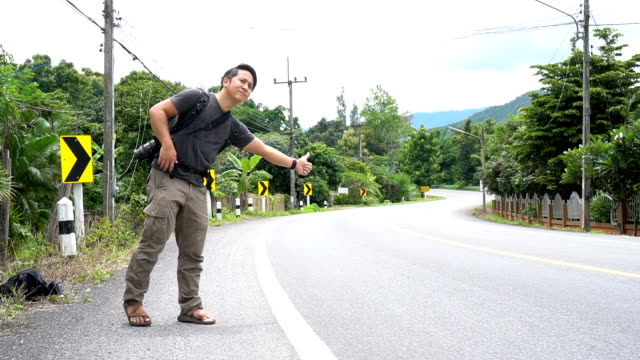 asian man asking for a ride in rural area - ordering stock videos & royalty-free footage
