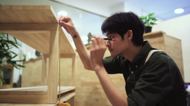 asian man assembling new furniture at home - instrument of measurement stock videos & royalty-free footage