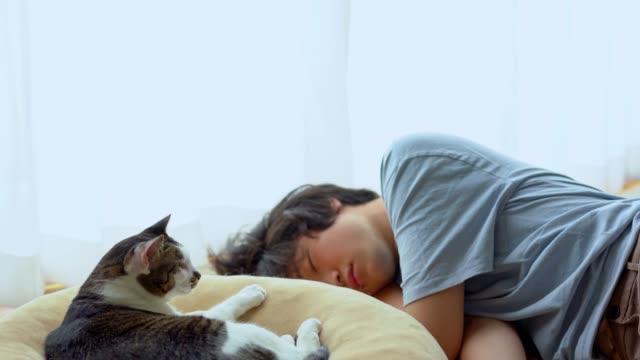 asian man at home taking a nap - napping stock videos & royalty-free footage