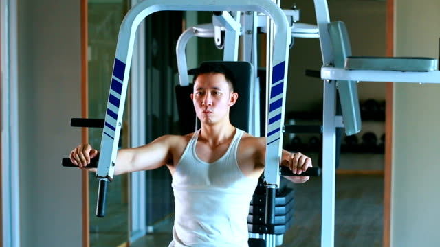Asian man attempt to exercising at gym-body weight training