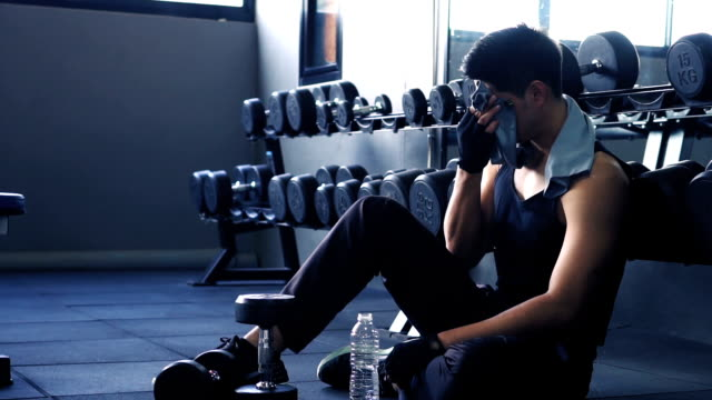Asian man break exercise in gym.