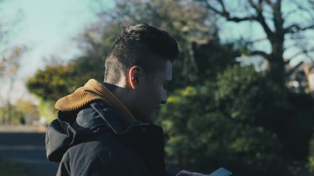 asian man browsing on his phone - modern manhood stock videos & royalty-free footage