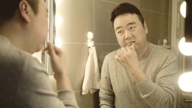 asian man brushing teeth - brushing teeth stock videos & royalty-free footage