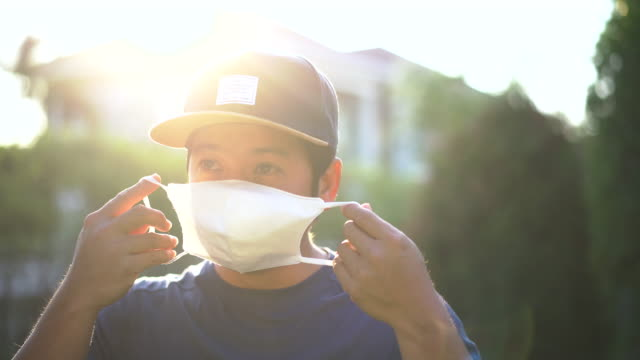 asian man coughing then wearing surgical mask - coughing stock videos & royalty-free footage