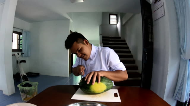 asian man cutting watermelon with knife - table knife stock videos & royalty-free footage