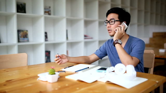 Asian Man discussing his work in co-working space
