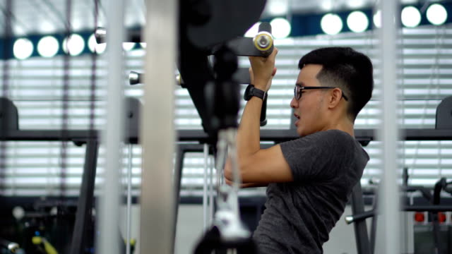 asian man doing chin up - asian stock videos & royalty-free footage