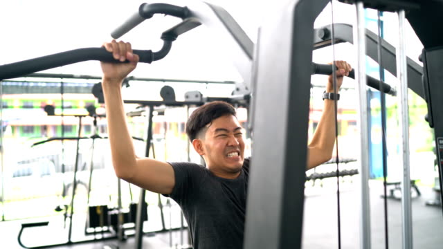 asian man doing exercise on pull-up bar - horizontal bar stock videos and b-roll footage