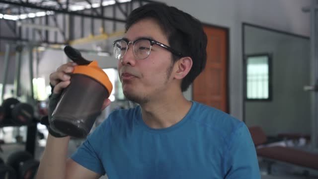 asian man drinking whey protein - protein stock videos & royalty-free footage