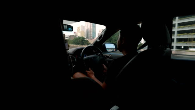 asian man driving car, road trip with friends in the city. - driving test stock videos and b-roll footage