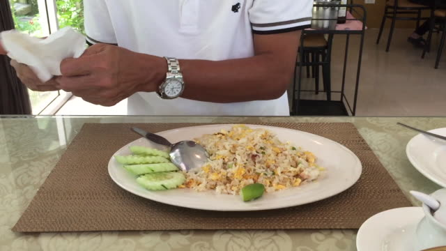 asian man eating fried rice - fried rice stock videos and b-roll footage