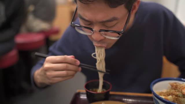 asian man eating japanese food set, cold soba pasta noodle and shrimp tempura - ramen noodles stock videos & royalty-free footage