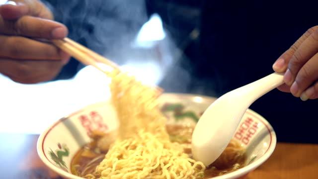 asian man eating ramen - ramen noodles stock videos & royalty-free footage