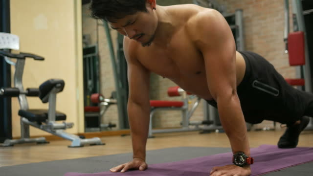 asian man exercising in fitness - washboard stock videos and b-roll footage