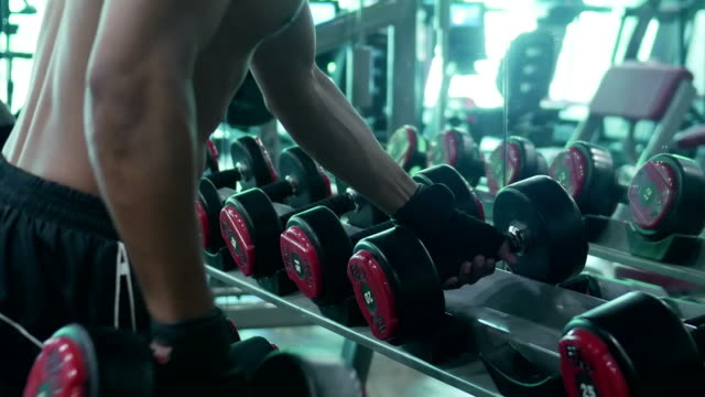 asian man exercising in fitness - deltoid stock videos and b-roll footage