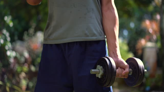 asian man exercising with a dumbbell - weight training stock videos & royalty-free footage