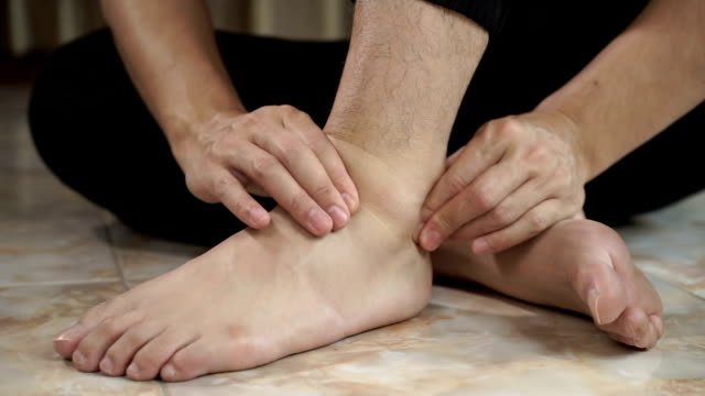 asian man feel pain on his foot and he massage on his foot