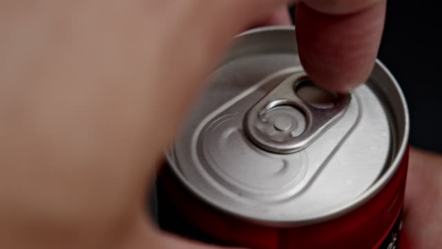 asian man hand opening on soda can - can stock videos & royalty-free footage