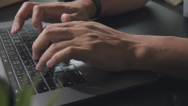 asian man hand typing or searching on laptop computer while stay home. close-up human finger speed typing e-mail to business partner. - human finger stock videos & royalty-free footage