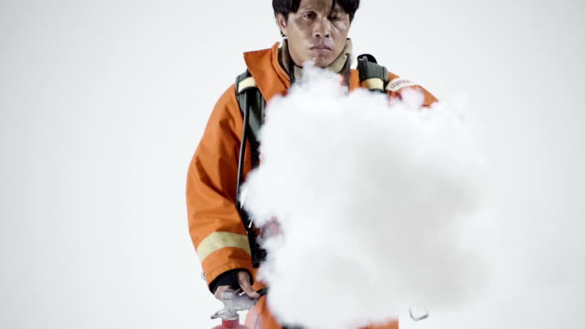 asian man holds a fire extinguisher - fire extinguisher stock videos & royalty-free footage