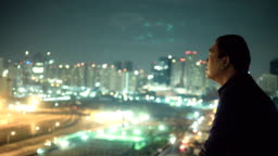 Asian Man Looking At City View