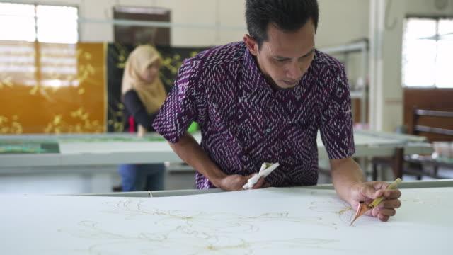 asian man making batik - batik stock videos and b-roll footage