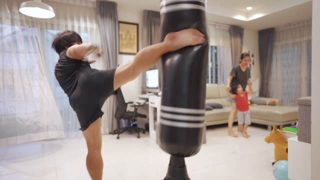 asian man man boxing training at home during covid-19. - prevenzione delle malattie video stock e b–roll