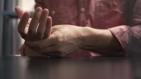 asian man massage on his hand pain - injured stock videos & royalty-free footage