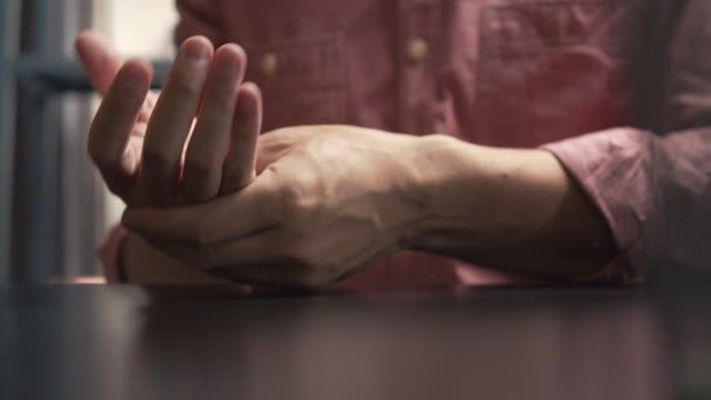 asian man massage on his hand pain - rheumatism stock videos & royalty-free footage