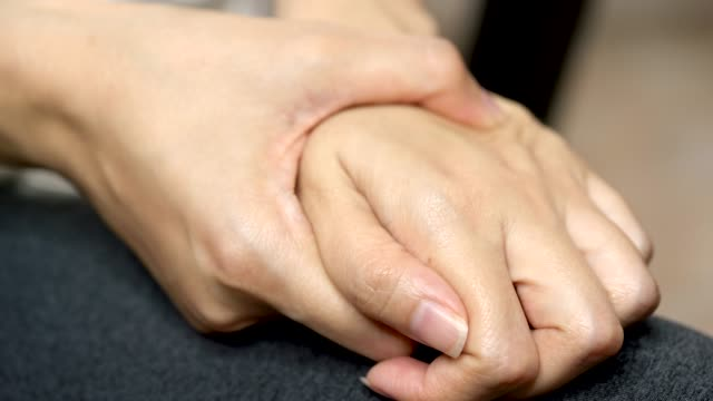 asian man massage on his hand pain - wrist stock videos & royalty-free footage