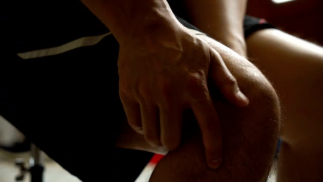 Asian Man Massage On His Knee Pain And Feeling Bad