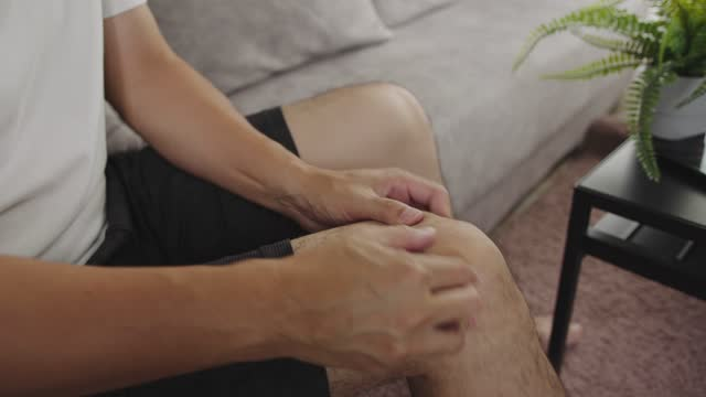 asian man massage on his knee pain and feeling bad.trigger point  healthcare concept - tendon stock videos & royalty-free footage