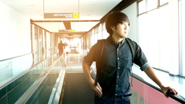 Asian man move on a travelator