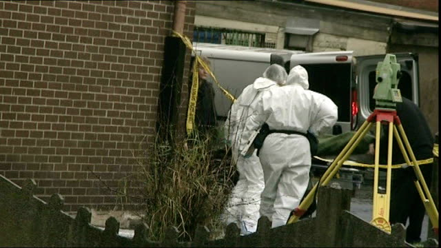 two teenagers arrested england greater manchester bolton ext forensic officers wearing protective suits next to forensic tent by scene of crime tape... - bolton greater manchester stock videos and b-roll footage