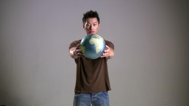 (HD1080i) Asian Man Offers World